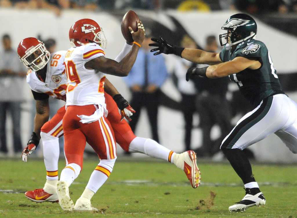 . Kansas City Chiefs safety Eric Berry intercepts a pass intended for Philadelphia Eagles tight end Brent Celek that was tipped by Chiefs linebacker Derrick Johnson in the first quarter, returning it for a touchdown during an NFL football game Thursday, Sept. 19, 2013, in Philadelphia. (AP Photo/Philadelphia Inquirer, Clem Murray)