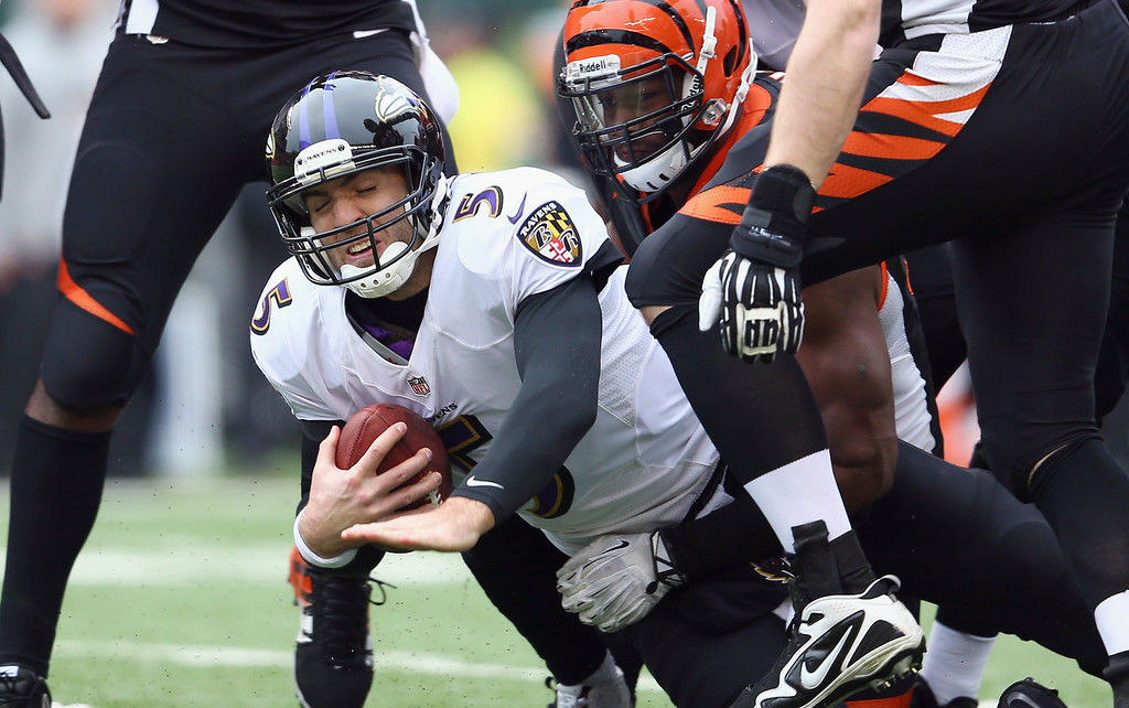 . Joe Flacco #5 of the Baltimore Ravens is sacked during the NFL game against the Cincinnati Bengals at Paul Brown Stadium on December 29, 2013 in Cincinnati, Ohio.  (Photo by Andy Lyons/Getty Images)