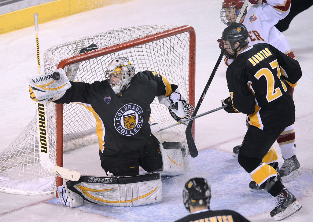 . DENVER, CO. - FEBRUARY 21, 2014: Colorado College goalie Josh Thorimbert (39) made a save late in the third period. The Colorado College hockey team defeated Denver 3-2 at Magness Arena Friday night, February 21, 2014. Photo By Karl Gehring/The Denver Post