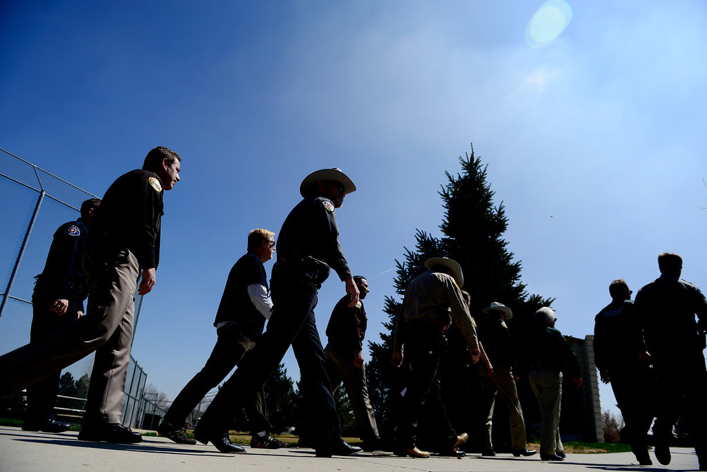 . DENVER, CO - APRIL 3: Sheriffs arrive at the podium to address the crowd. Sheriffs from around the state gathered to speak out against gun control before President Barack Obama was set to give a speech at the Denver Police Academy about a mile away. (Photo by AAron Ontiveroz/The Denver Post)