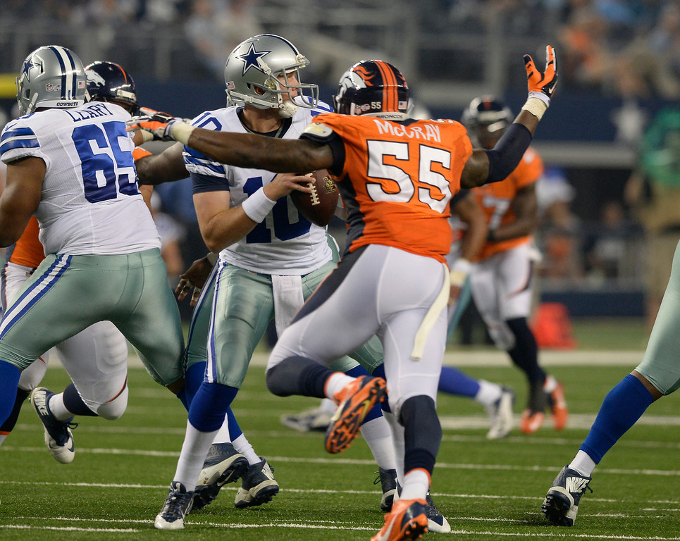 . ARLINGTON, TX - AUGUST 28: Dallas Cowboys quarterback Dustin Vaughan (10) gets press from Denver Broncos outside linebacker Lerentee McCray (55) during the second quarter August 28, 2014 at AT&T Stadium. (Photo by John Leyba/The Denver Post)