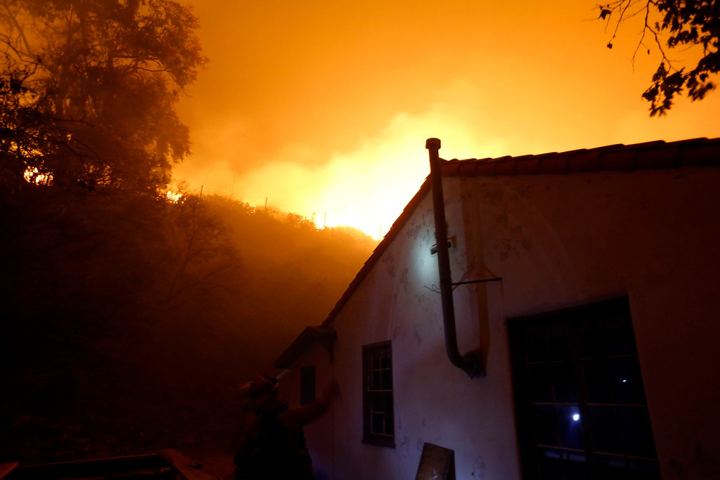 . A firefighter gestures as he and his colleagues battle to protect the Sycamore Nature Center  from the Springs Fire near Pacific Coast Highway and the Los Angeles County Line at Malibu, California, May 2, 2013. REUTERS/Patrick T. Fallon
