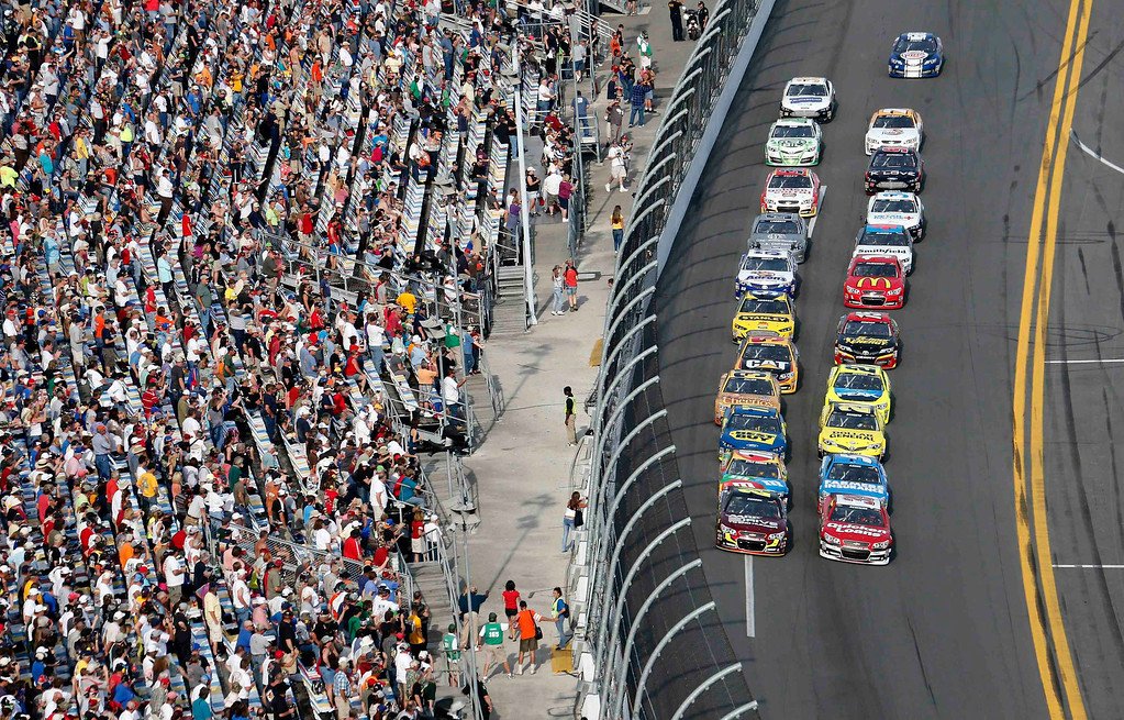 . Fans look on from the grandstand at the start of the second NASCAR Sprint Cup Series Budweiser Duel at the Daytona International Speedway in Daytona Beach, Florida February 21, 2013. The two Duel races determine starting positions for the field for the Daytona 500 NASCAR Sprint Cup race scheduled for February 24.  REUTERS/Pierre Ducharme