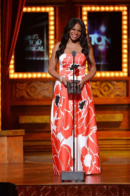 """. Audra McDonald accepts the award for Best Performance by an Actress in a Leading Role in a Play for ?\""""Lady Day\""""? onstage during the 68th Annual Tony Awards at Radio City Music Hall on June 8, 2014 in New York City.  (Photo by Theo Wargo/Getty Images for Tony Awards Productions)"""