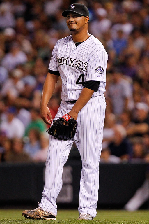 . Colorado Rockies starting pitcher Jhoulys Chacin reacts after his no-hitter was broken with a single by a San Francisco Giants\' Brandon Crawford during the seventh inning of a baseball game, Wednesday, Aug. 28, 2013, in Denver. (AP Photo/Barry Gutierrez)