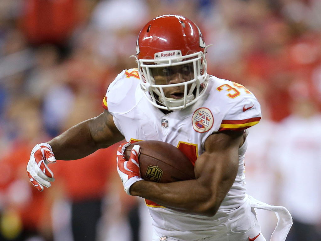 . Kansas City Chiefs running back Knile Davis (34) runs during the first half of an NFL wild-card playoff football game against the Indianapolis Colts Saturday, Jan. 4, 2014, in Indianapolis. (AP Photo/AJ Mast)
