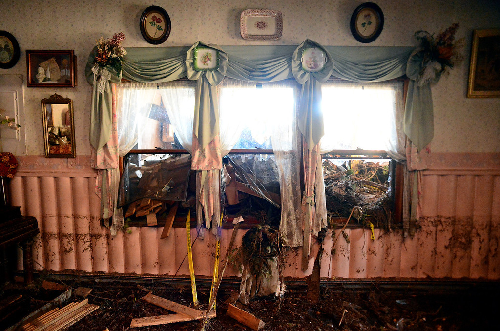 . GLEN HAVEN, CO - OCTOBER 8: Debris still stuff windowsills in the  historic Glen Haven Inn in Glen Haven, CO on October 8, 2013.  The Inn was one of the only businesses that actually made it in the town but has been inundated with mud and debris.  The water line along the walls suggest that the flood waters reached at least four feet inside the building.  (Photo By Helen H. Richardson/ The Denver Post)
