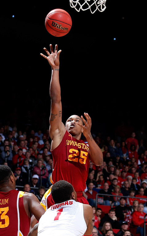 . Tyrus McGee #25 of the Iowa State Cyclones drives to the basket against Deshaun Thomas #1 of the Ohio State Buckeyes in the second half during the third round of the 2013 NCAA Men\'s Basketball Tournament at UD Arena on March 24, 2013 in Dayton, Ohio.  (Photo by Joe Robbins/Getty Images)