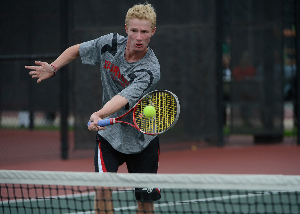 . DENVER, CO - OCTOBER 11:   Thomas Mason, Fairview High School, hits a shot near the net against opponent, Derek Wright, Monarch High School, (not pictured) during his #3 semi-final match at the 2013 State 5A Tennis Championships at the Gates Tennis Center in Denver, Colorado Friday morning, October 11, 2013. Mason won the match. (Photo By Andy Cross/The Denver Post)