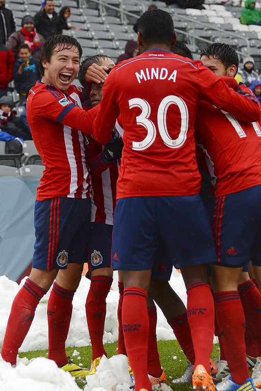 . Teammates celebrates with Marvin Chavez (38) of Chivas USA after he scored the first of his two goals against the Colorado Rapids during the second half. Chivas USA defeated the Colorado Rapids 3-1 on Sunday, May 11, 2014. (Photo by AAron Ontiveroz/The Denver Post)