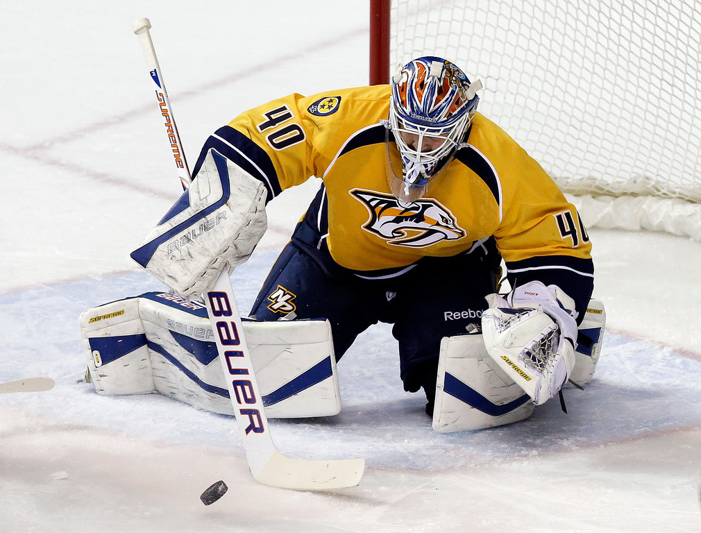 . Nashville Predators goalie Devan Dubnyk (40) makes a stop against the Colorado Avalanche in the second period of an NHL hockey game Saturday, Jan. 18, 2014, in Nashville, Tenn. The game is Dubnyk\'s first in goal for the Predators since being acquired from the Edmonton Oilers. (AP Photo/Mark Humphrey)