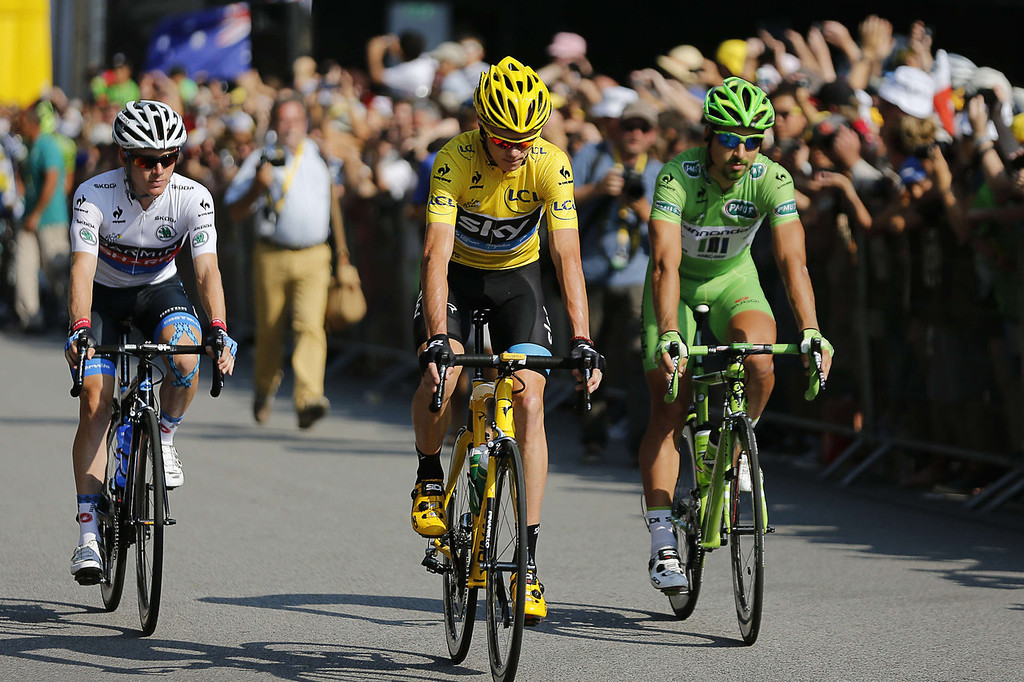 . (From L) Best young\'s white jersey USA\'s Andrew Talansky, overall leader\'s yellow jersey Britain\'s Christopher Froome and best sprinter\'s green jersey Slovakia\'s Peter Sagan, ride in Versailles, outside Paris, at the the start of the 133.5 km twenty-first and last stage of the 100th edition of the Tour de France cycling race on July 21, 2013 between Versailles and Paris.  JEFF PACHOUD/AFP/Getty Images