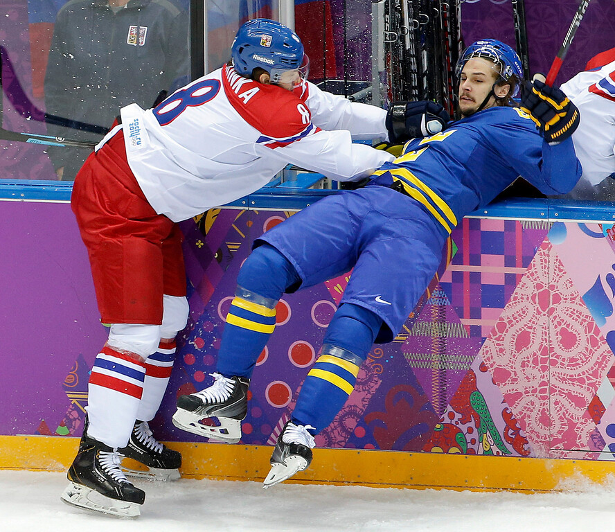 . Czech Republic Michal Barinka checks Sweden defensemand Erik Karlsson in the first period of a men\'s ice hockey game at the 2014 Winter Olympics, Wednesday, Feb. 12, 2014, in Sochi, Russia. (AP Photo/Julio Cortez)