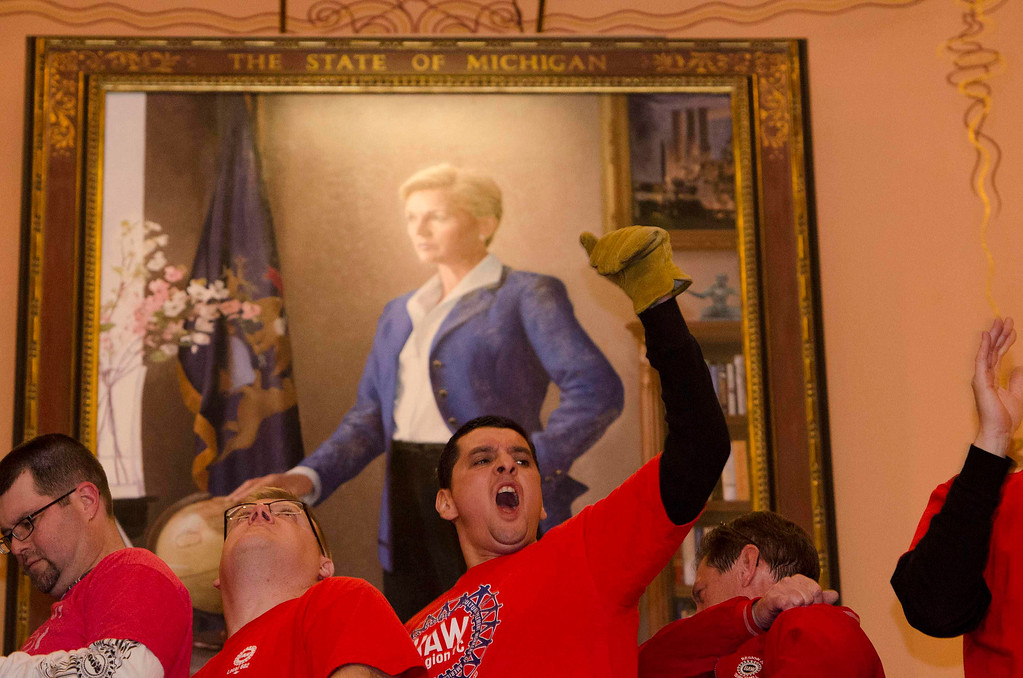 . Labor union members and supporters demonstrate in opposition to a proposed right-to-work measure in Lansing, Michigan December 11, 2012.  Michigan legislators on Tuesday approved laws that ban mandatory membership in public and private sector unions, dealing a stunning blow to organized labor in the home of the U.S. auto industry.  REUTERS/James Fassinger