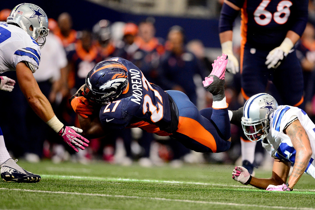 . Knowshon Moreno (27) of the Denver Broncos dives for yards against the Dallas Cowboys during the first half of action at AT&T Stadium.   (Photo by AAron Ontiveroz/The Denver Post)