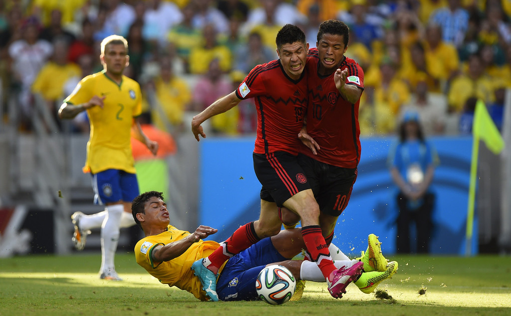. Brazil\'s defender Thiago Silva (down) vies with Mexico\'s forward Giovani Dos Santos (R) and Mexico\'s forward Oribe Peralta (C) during a Group A football match between Brazil and Mexico in the Castelao Stadium in Fortaleza during the 2014 FIFA World Cup on June 17, 2014. ODD ANDERSEN/AFP/Getty Images