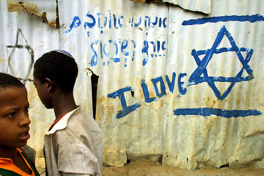 ". ADDIS ABABA, ETHIOPIA - MARCH 14:  Jewish Ethiopian students walk to their classes at the Beta Israel School March 14, 2003 in Addis Ababa, Ethiopia. After airlifting more than 22,000 Ethiopian Jews in 1984, and 1991, and satisfied that all qualified Jews had left Ethiopia in the airlifts, the Israeli government closed down its offices in Addis Ababa. However, in recent years, those Jews who were left behind have moved from their villages to Addis Ababa and are waiting for the Israeli government to accept them under the ""Law of Return.\"" Nearly 17,000 Ethiopian Jews awaiting aliyah, or emigration to Israel, live in Addis Ababa and the northern city of Gondar. For reasons that include a limited paper trail authenticating their Jewish identity, conversions to Christianity by grandparents, or a reluctance on the part of Israel to accept more Ethiopian refugees, the Ethiopian Jews have lingered around in compounds waiting indefinitely.  (Photo by Natalie Behring-Chisholm/Getty Images)"