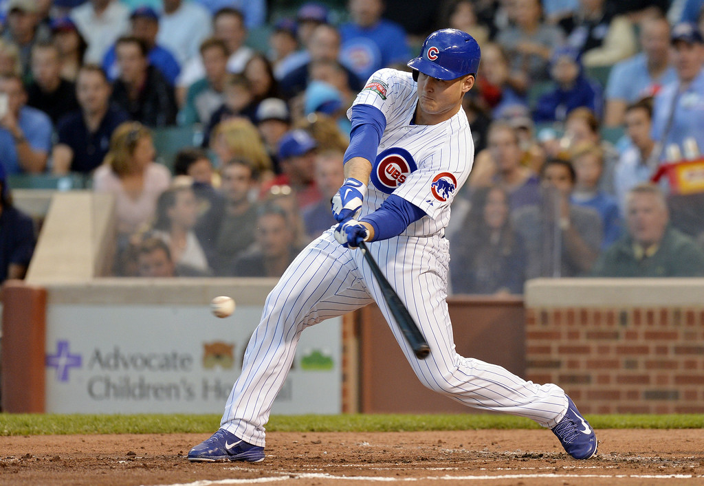 . Anthony Rizzo #44 of the Chicago Cubs connects on an RBI single, scoring Emilio Bonifacio during the first inning on July 29, 2014 at Wrigley Field in Chicago, Illinois.  (Photo by Brian Kersey/Getty Images)