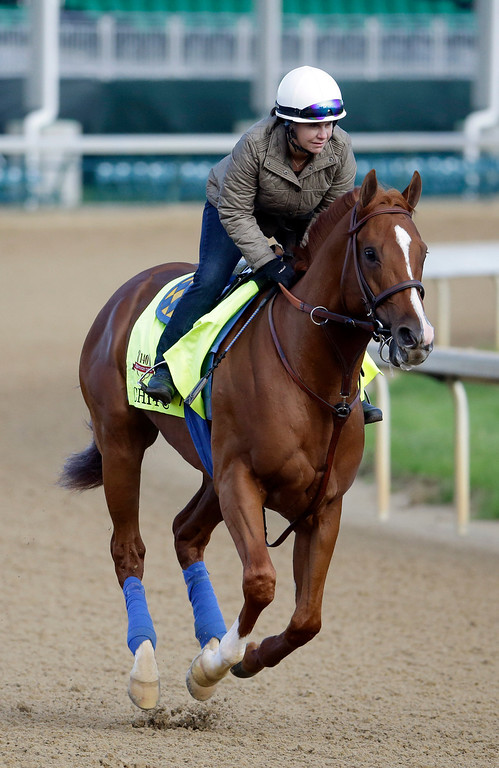 . Exercise rider Dana Barnes takes Kentucky Derby entrant Chitu for a morning workout at Churchill Downs Thursday, May 1, 2014, in Louisville, Ky. (AP Photo/Morry Gash)