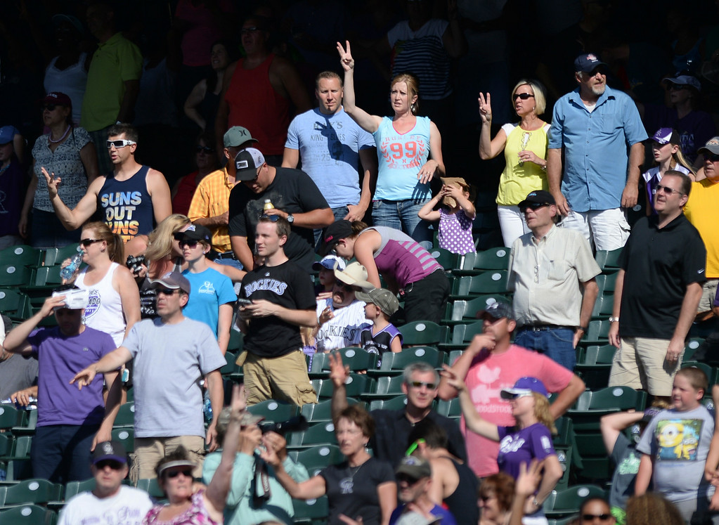 . DENVER, CO - JULY 5:  Fans sang along with Take Me Out to the Ballgame at Coors Field on a very warm Saturday afternoon. The Colorado Rockies defeated the Los Angeles Dodgers 8-7 at Coors Field Saturday afternoon, July 5, 2014.  Photo by Karl Gehring/The Denver Post