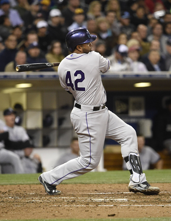 . SAN DIEGO, CA - APRIL 15:  Wilin Rosario of the Colorado Rockies hits an RBI single during the fifth inning of a baseball game against the San Diego Padres at Petco Park April 15, 2014 in San Diego, California.  All uniformed team members are wearing jersey number 42 in honor of Jackie Robinson Day.  (Photo by Denis Poroy/Getty Images)