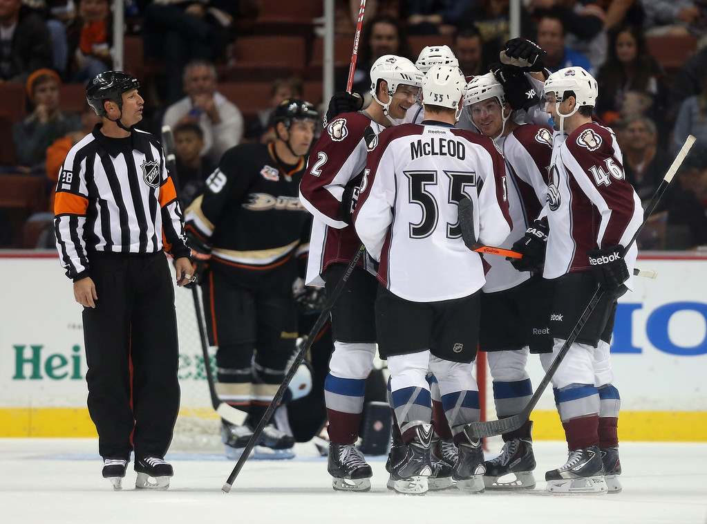 . (L-R) Nick Holden #2, Cody McLeod #55, Brad Malone #42 and Stefan Elliott #46 of the Colorado Avalanche celebrate Malone\'s third period goal against the Anaheim Ducks at Honda Center on September 22, 2013 in Anaheim, California. The Avalanche defeated the Ducks 2-1.  (Photo by Jeff Gross/Getty Images)