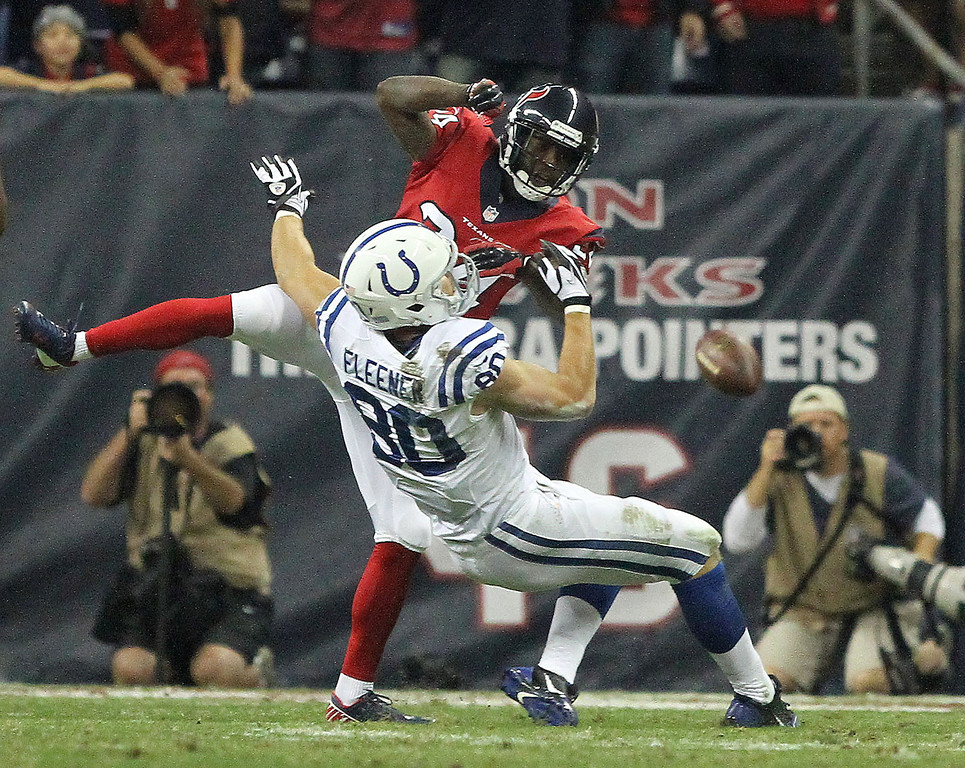 . Houston Texans cornerback Johnathan Joseph (24) hits Indianapolis Colts tight end Coby Fleener (80) knocking the ball loose during the first half of an NFL football game, Sunday, Nov. 3, 2013, in Houston. (AP Photo/ The Courier, Jason Fochtman)