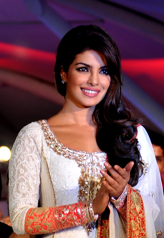. Indian Bollywood film actress Priyanka Chopra walks the ramp during the seventh annual Pidilite-CPAA Charity Fashion Show showcasing designers Manish Malhotra and Shaina NC in support of the Cancer Patients Aid Association (CPAA) in Mumbai on July 1, 2012.  STRDEL/AFP/GettyImages