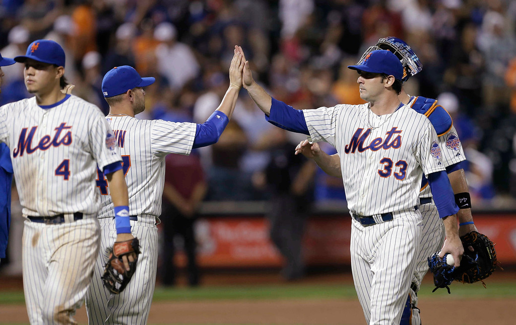 . New York Mets\' Matt Harvey (33) celebrates with teammates after a baseball game against the Colorado Rockies on Wednesday, Aug. 7, 2013, in New York. The Mets won 5-0. (AP Photo/Frank Franklin II)