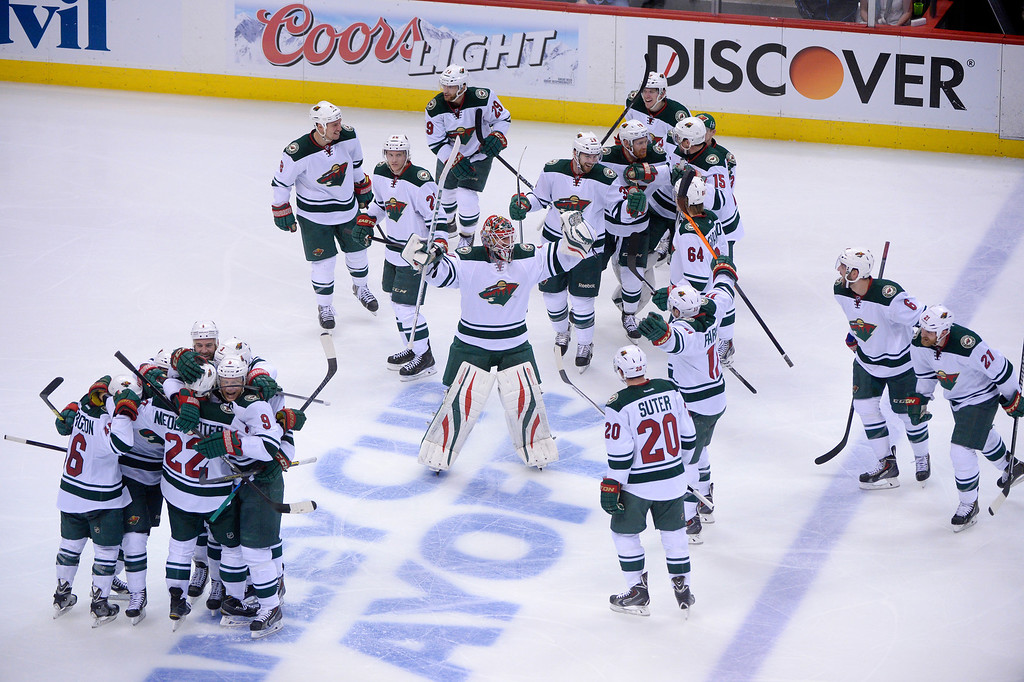 . Minnesota Wild players celebrate after the game. The Colorado Avalanche fell 5-4 to the Minnesota Wild in game 7 of their Stanley Cup Playoff series at the Pepsi Center in Denver, Colorado on Wednesday, April 30, 2014. (Photo by Karl Gehring/The Denver Post)