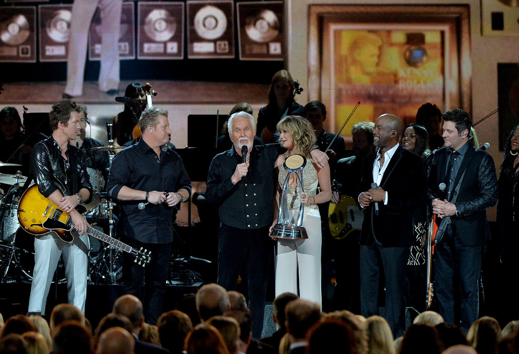 . NASHVILLE, TN - NOVEMBER 06:  (L-R) Joe Don Rooney, Jay DeMarcus, Willie Nelson Lifetime Achievement Award winner Kenny Rogers, Jennifer Nettles, Darius Rucker and Gary LeVox onstge during the 47th annual CMA awards at the Bridgestone Arena on November 6, 2013 in Nashville, United States.  (Photo by Rick Diamond/Getty Images)