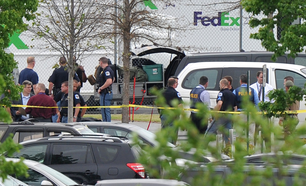 . Police officials rope off the scene of a shooting at a FedEx facility in Kennesaw, Ga., on Tuesday, April 29, 2014.  (AP Photo/Atlanta Journal-Constitution, Brant Sanderlin)