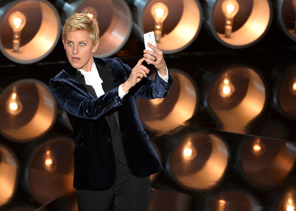 . Host Ellen DeGeneres speaks onstage during the Oscars at the Dolby Theatre on March 2, 2014 in Hollywood, California.  (Photo by Kevin Winter/Getty Images)