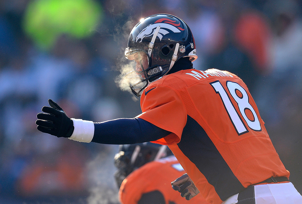 . Denver Broncos quarterback Peyton Manning (18) calls plays from the line in the first quarter during the Broncos\' game against the Tennessee Titans on December 8, 2013. (Photo by John Leyba/The Denver Post)