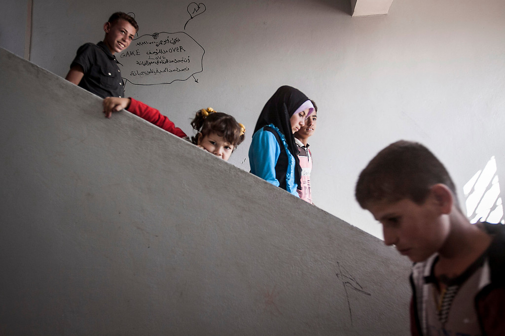 . In this Thursday, Sept. 26, 2013 photo, Syrian children walk downstairs at the public school in Madaya village as classes begin in the Idlib province countryside of Syria. Millions of Syrian children most of them in government-controlled areas have returned to school in the past two weeks, despite the conflict that according to UNICEF has left 4,000 Syrian schools or one in five damaged, destroyed or sheltering displaced families. (AP Photo)