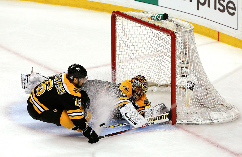 . Tuukka Rask #40 of the Boston Bruins tends goal as Kaspars Daugavins #16 skates in against the Chicago Blackhawks in Game Three of the 2013 NHL Stanley Cup Final at TD Garden on June 17, 2013 in Boston, Massachusetts.  (Photo by Jim Rogash/Getty Images)