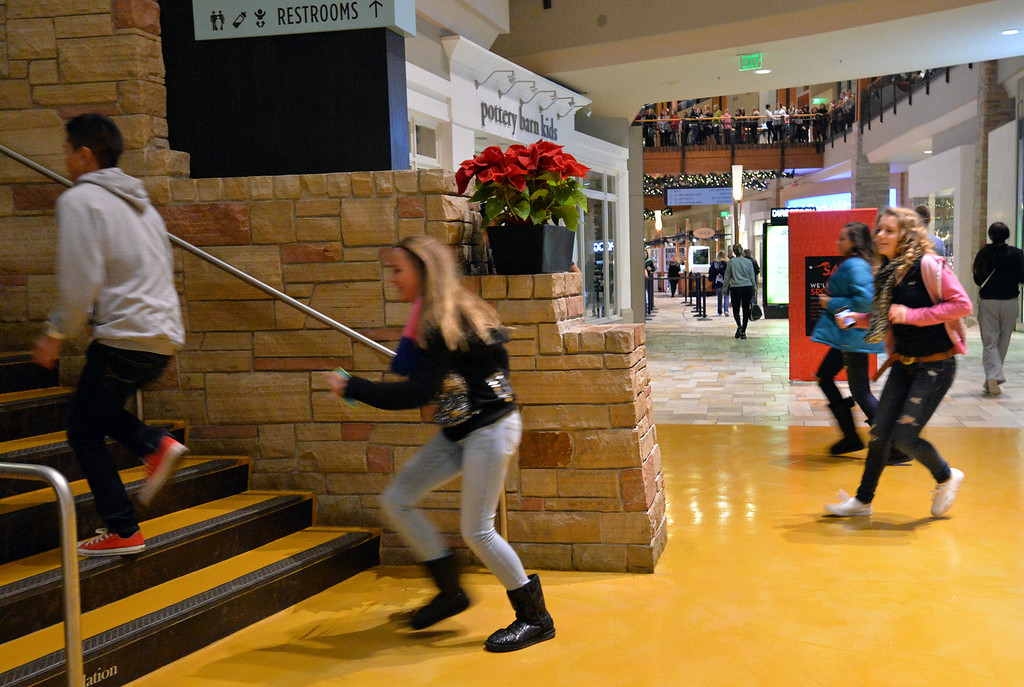 . Shoppers run to their favorite store for Black Thursday and Friday at FlatIron Crossing mall on Thursday, November 28, 2013. David R. Jennings/Boulder Daily Camera