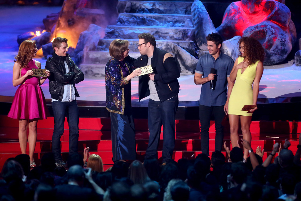 . (L-R) Actors Peyton McCormick, Dave Franco, Sandra Daubert, Seth Rogen, Zac Efron and Tiffany Luce speak onstage at the 2014 MTV Movie Awards at Nokia Theatre L.A. Live on April 13, 2014 in Los Angeles, California.  (Photo by Frederick M. Brown/Getty Images)