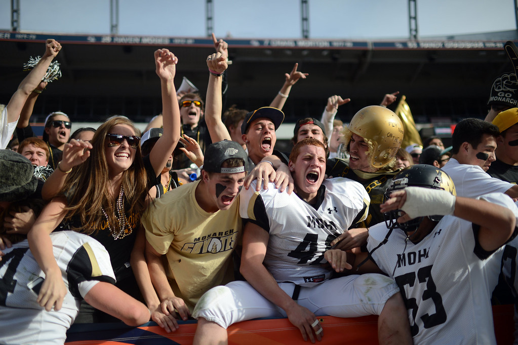. Monarch High School football team and students celebrate their win in the 4A State Championship game against Denver South at Sports Authority Field at Mile High. Monarch won 17-14. Hyoung Chang, The Denver Post