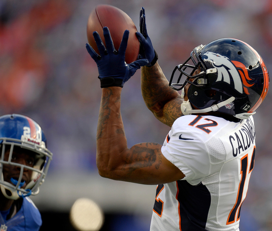 . Wide receiver Andre Caldwell (12) of the Denver Broncos catches a 36 yard pass during the first quarter against the New York Giants September 15, 2013 MetLife Stadium. (Photo by John Leyba/The Denver Post)