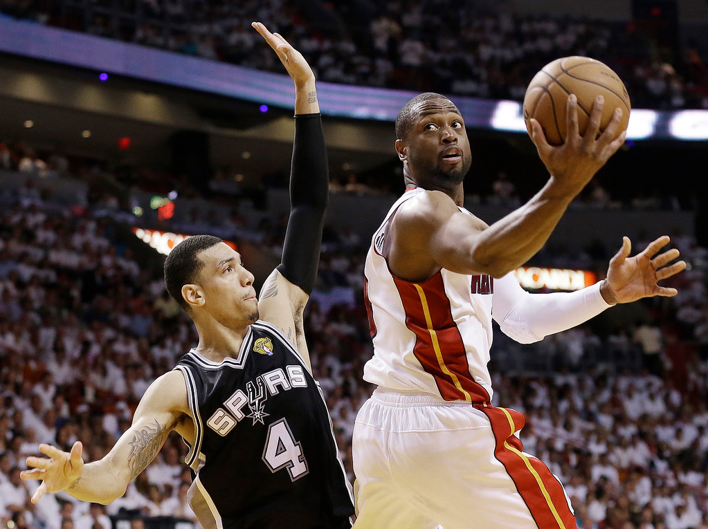 . Miami Heat shooting guard Dwyane Wade (3) shoots against San Antonio Spurs shooting guard Danny Green (4) during the second half of Game 6 of the NBA Finals basketball game, Tuesday, June 18, 2013 in Miami. (AP Photo/Lynne Sladky)