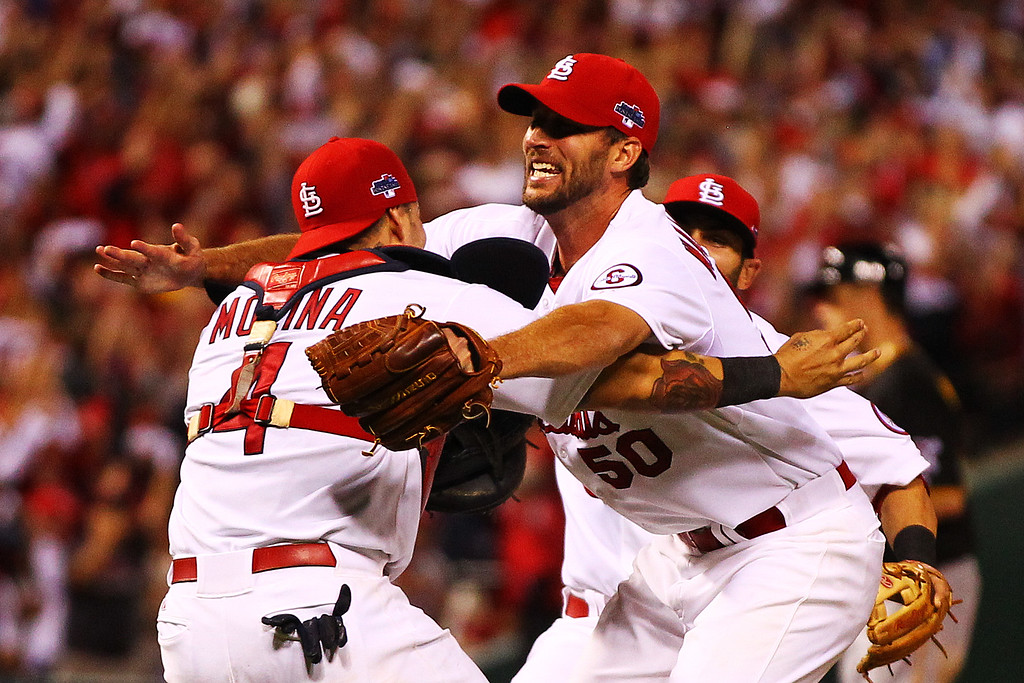 . ST LOUIS, MO - OCTOBER 09:  Adam Wainwright #50 celebrates with Yadier Molina #4 of the St. Louis Cardinals after they defeated the Pittsburgh Pirates 6 to 1 in Game Five of the National League Division Series at Busch Stadium on October 9, 2013 in St Louis, Missouri.  (Photo by Dilip Vishwanat/Getty Images)