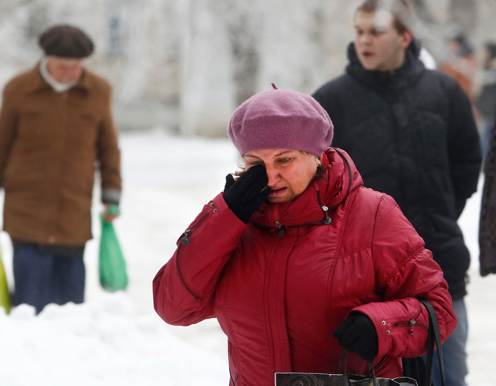 . A Volgograd resident walks crying in Volgograd, Russia early Monday, Dec. 30, 2013. A bomb blast tore through a trolleybus in the city of Volgograd on Monday morning, killing at least 10 people a day after a suicide bombing that killed at least 17 at the city\'s main railway station. Volgograd is about 400 miles northeast of Sochi, where the Olympics are to be held. (AP Photo/Denis Tyrin)