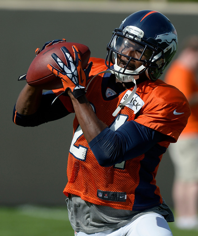 . Denver Broncos CB Champ Bailey (24) catches a pass in drills during training camp August 6, 2013 at Dove Valley. (Photo By John Leyba/The Denver Post)