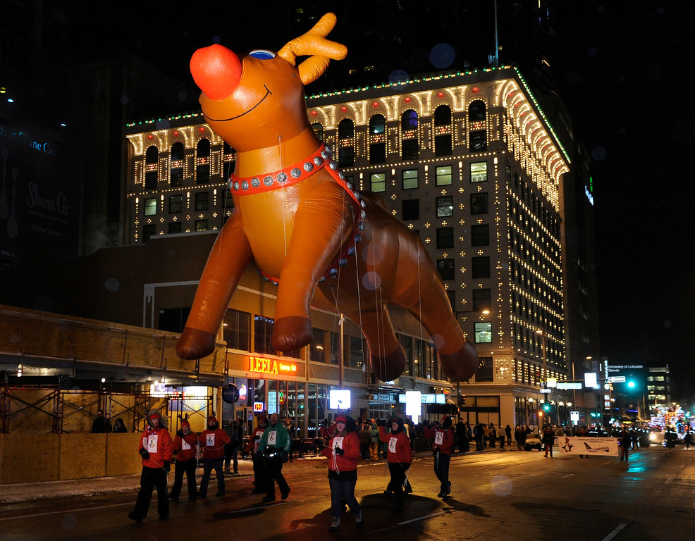 . DENVER, CO. - DECEMBER 06: Rudolph let his red nose light the way down 15th Street in downtown Denver as the 9News Parade of Lights kicked off Friday night, December 6, 2013. The weather was clear but temperatures dipped below zero. Photo By Karl Gehring/The Denver Post