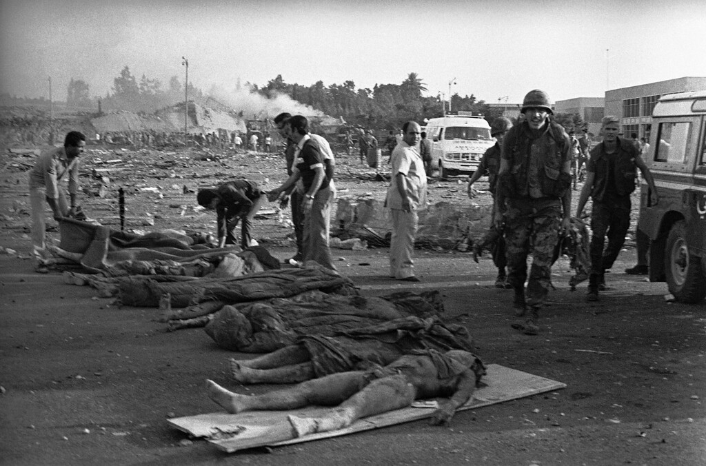 . In this Sunday, Oct. 23, 1983, file photo, U.S. Marines carry their dead comrades away from the four-story barracks building that was destroyed in a suicide truck bomb blast, near Beirut airport, Lebanon. The blast _ the single deadliest attack on U.S. forces abroad since World War II _ claimed the lives of 241 American service members.(AP Photo/Assad Jeradeh,File)