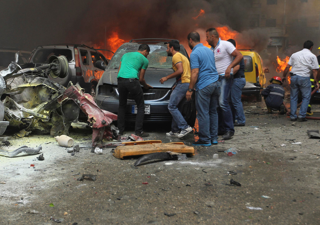 . People gather at the site of an explosion in Beirut\'s southern suburbs July 9, 2013. REUTERS/Hasan Shaaban