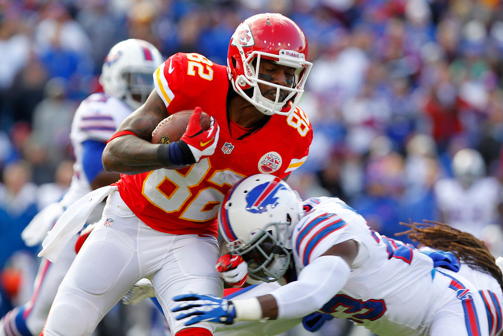 . Kansas City Chiefs wide receiver Dwayne Bowe (82) is tackled by Buffalo Bills free safety Aaron Williams (23) after a 12-yard gain during the first quarter of an NFL football game in Orchard Park, N.Y., Sunday, Nov. 3, 2013. (AP Photo/  Bill Wippert)