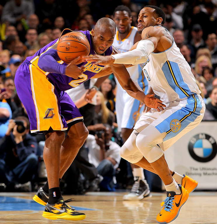 . Andre Iguodala #9 of the Denver Nuggets knocks the ball away from Kobe Bryant #24 of the Los Angeles Lakers at the Pepsi Center on February 25, 2013 in Denver, Colorado. NOTE TO USER: User expressly acknowledges and agrees that, by downloading and or using this photograph, User is consenting to the terms and conditions of the Getty Images License Agreement.  (Photo by Doug Pensinger/Getty Images)