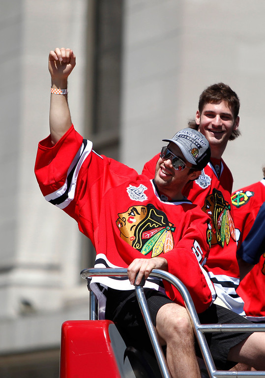 . Chicago Blackhawks goalie Corey Crawford, left, and left wing Brandon Saad ride in the 2013 Stanley Cup Champion victory parade down Washington Street Friday, June 28, 2013 in Chicago. The Blackhawks celebrate the team\'s second championship in four years. (AP Photo/Scott Eisen)